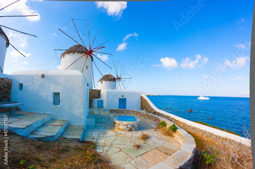 Платно Panoramic view of two windmills and their bases Mykonos Greece C
