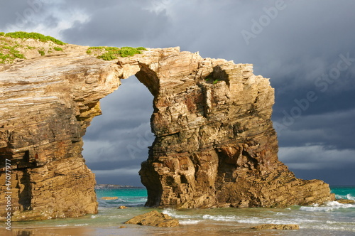 Las Catedrales beach, Ribadeo, Spain. Last ray of sun in the ear