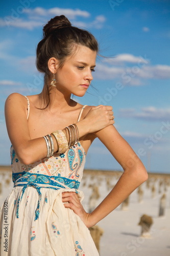 Fototapety, obrazy: The beautiful girl costs in the field to the blue sky