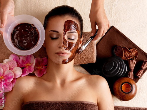 Spa therapy for woman receiving cosmetic mask Canvas Print