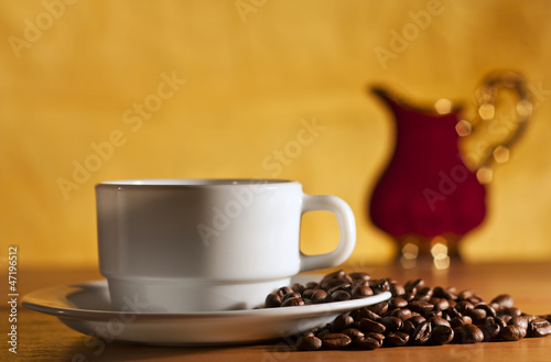 Printed kitchen splashbacks Chocolate White cup of coffee and saucer still life
