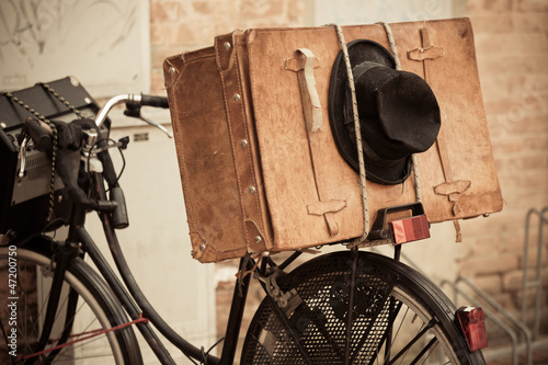 Black Hat and Brown Suitcase on Old Bicycle © dvoevnore