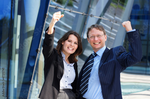 Fototapety, obrazy: A couple of young business persons in formal clothes
