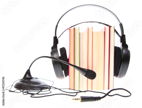 Valokuva  Books stack and headset with a microphone isolated