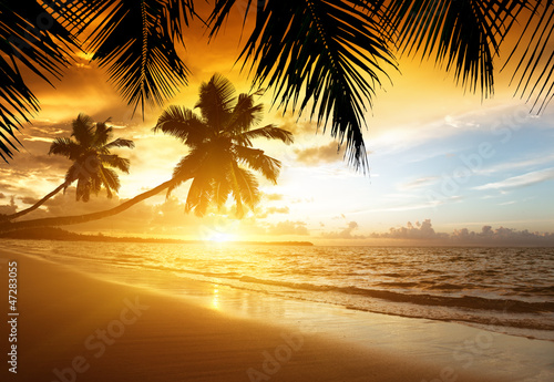 sunset on the beach of caribbean sea - 47283055