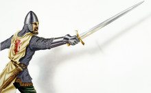 Middle Age Ancient Warrior With A Sword, In Action. On White Bac