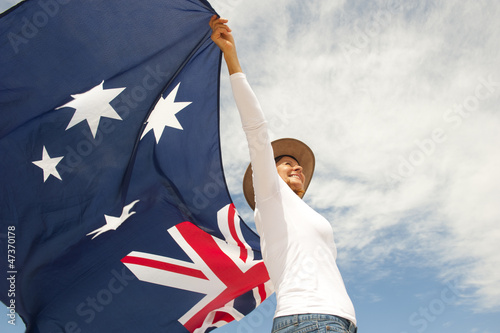 Woman with akubra hat and Australian flag Wallpaper Mural