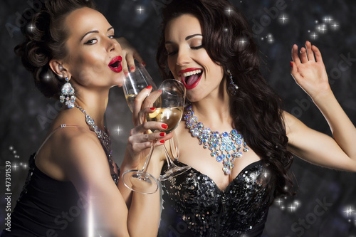 Poster  Happy Laughing Women Drinking Champagne and Singing Xmas Song
