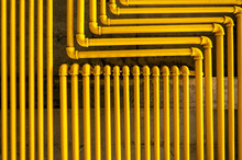 An Image Of Yellow Pipes Forming An Interesting Pattern.