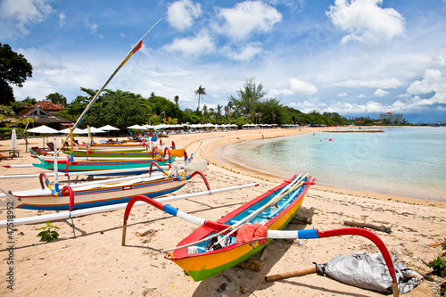 Wall Murals Bali Traditional fishing boats on a beach in Sanur on Bali