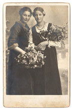 Portrait Of Two Young Women With Flowers
