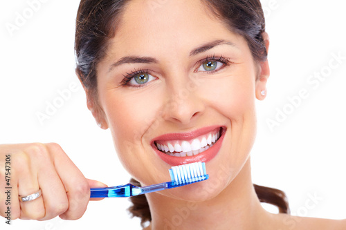 Beautiful woman smile with a toothbrush. - 47547306