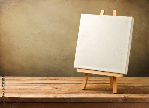 Photo  Background with blank canvas on wooden table