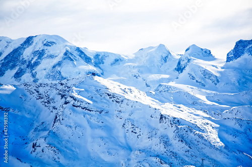 Fototapety, obrazy: Swiss alps landscape with blue snow
