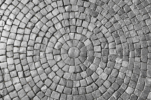 Texture of cobblestone in old town. Wallpaper Mural