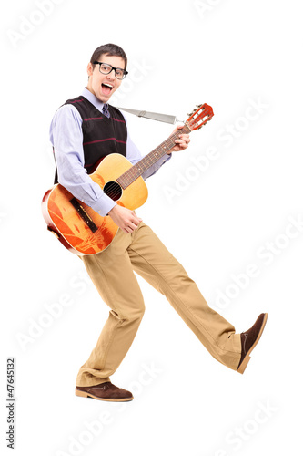 Keuken foto achterwand Art Studio Full length portrait of a happy male playing a guitar