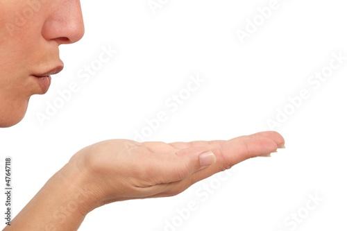 Valokuvatapetti Woman blowing on her open hand