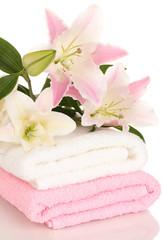 Obraz na płótnie Canvas beautiful lily on towel isolated on white