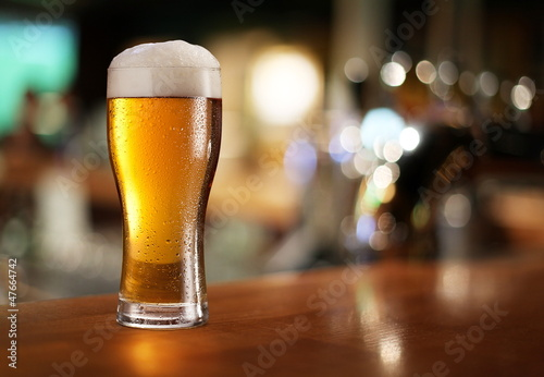 Glass of light beer. Canvas Print