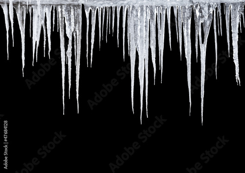 Fotomural Icicles on a black background