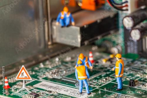 Fotografia  cantiere in miniatura,tecnologia informatica,uomini al lavoro