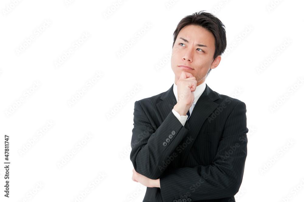 Fototapeta ちょっと上を向いて考える若いビジネスマン