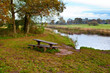 wooden table and benches by river