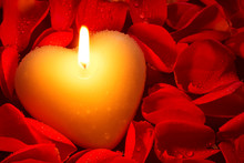 Heart Shape Candle And Rose Petals