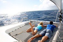 Couple Relaxing On Catamaran N...