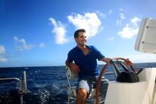 Smiling Young Sailor Navigating In Caribbean Sea