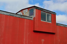 Train Engineers Perch On A Red Caboose Train Car