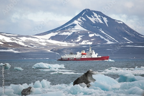Red ship in the Arctic fjiord - Spitsbergen