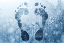 Male Foot Prints On Frozen Win...
