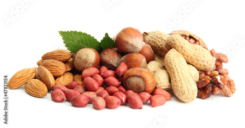 Fényképezés  assortment of tasty nuts with leaves, isolated on white