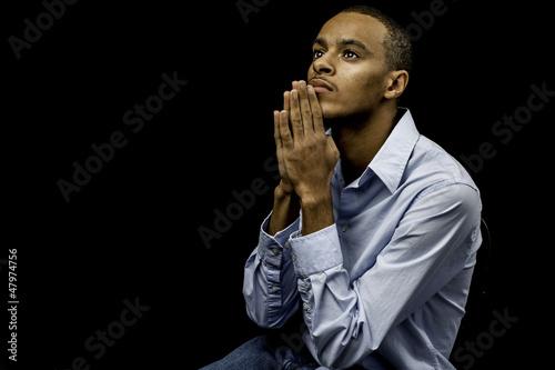 Fotografie, Obraz  Young black male praying