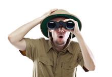 Amazed Explorer Looking Through Binoculars