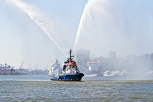 Blue Fire Boat Spraying Water In Amsterdam Harbor Netherlands
