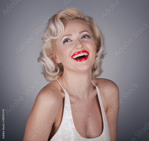 Photo  Pretty blond girl model like Marilyn Monroe in white dress