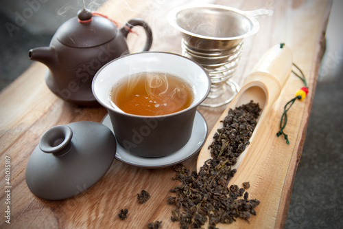 Cup of oolong tea and accessories #48035187