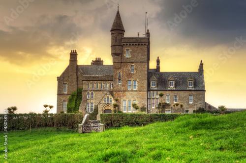 Tuinposter Zwavel geel Classiebawn Castle at sunset in Co. Sligo, Ireland