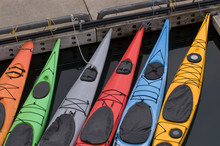 Colorful Kayaks Tied At Dock