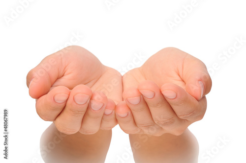 Fotografia, Obraz Beautiful cupped hands of young woman - cut out on white