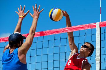 Fototapeta Beach volleyball tournament - attack and block