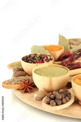 Staande foto Kruiden 2 wooden bowls and spoons with spices, isolated on white