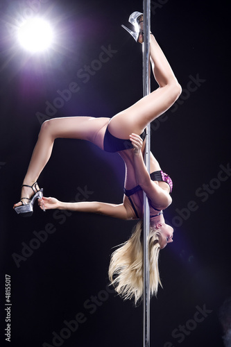 Young sexy woman exercise pole dance against a black background - 48155017