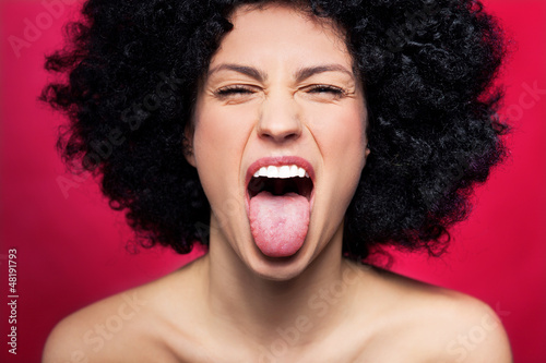 Fotografie, Obraz Woman sticking her tongue out