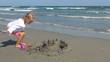 Playing on the Beach, Little Girl Having Fun with a Sand Castle
