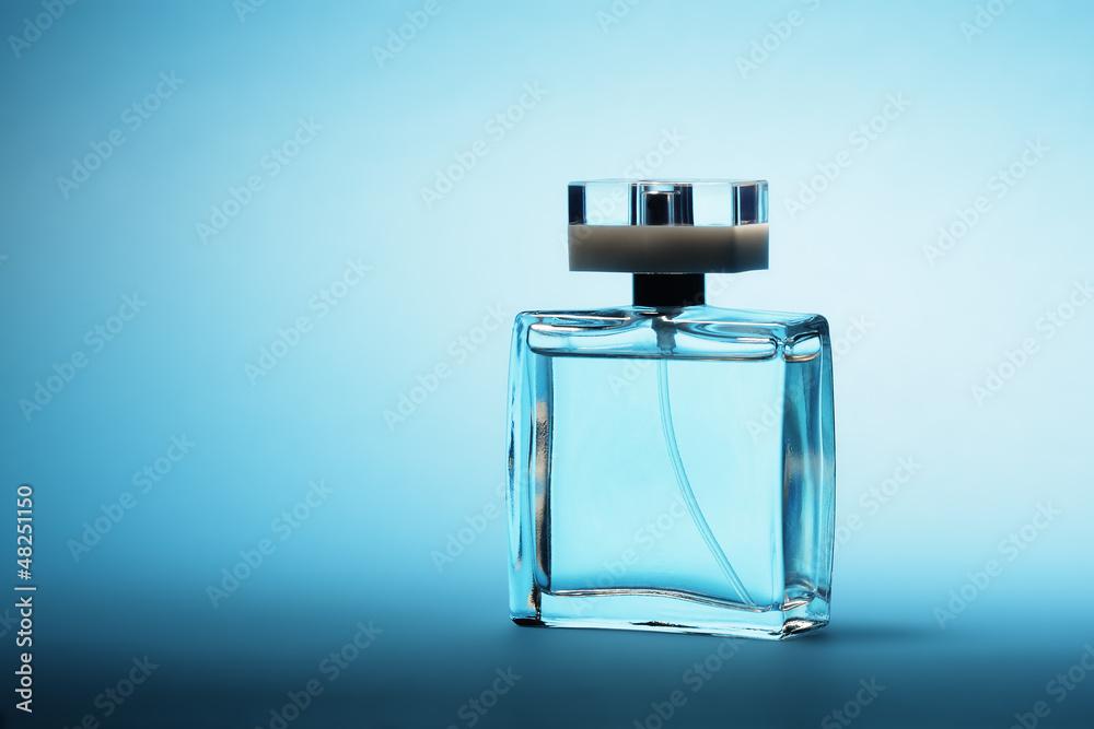 Fototapety, obrazy: Perfume on blue background