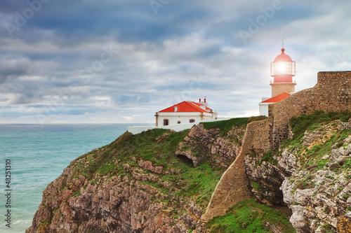 Fotografie, Obraz Historic lighthouse at Cape Sea. Portugal.