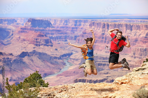 Tablou Canvas Happy people jumping in Grand Canyon